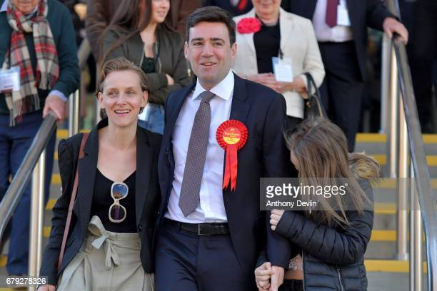 Labour's Andy Burnham celebrates winning the Greater Manchester mayoral election with wife MarieFrance van Heel and daughter Annie at Manchester...