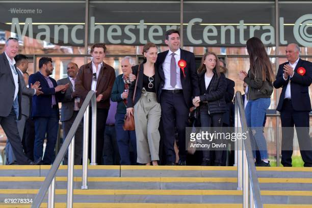 Labour's Andy Burnham celebrates winning the Greater Manchester mayoral election with wife MarieFrance van Heel and daughters Annie and Rosie at...