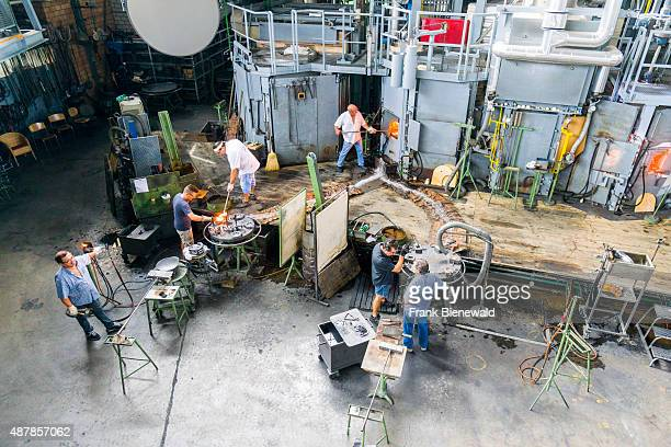 HERGISWIL LUZERN SWITZERLAND Labours are working in the glass blowers factory 'Glasi'