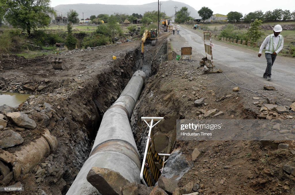 Labours busy working on a new water pipeline at Bhama Asakhed Dam near Khed, on June 13, 2018 in Pune, India.