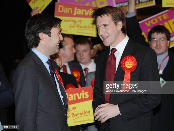 Labour's Dan Jarvis celebrates his victory with MP Andy Burnham in the Metrodome Complex Barnsley