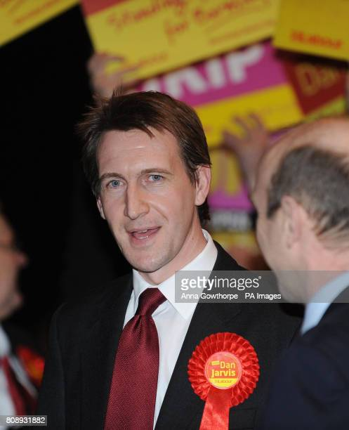 Labour's Dan Jarvis celebrates his victory with MP John Healey in the Metrodome Complex Barnsley