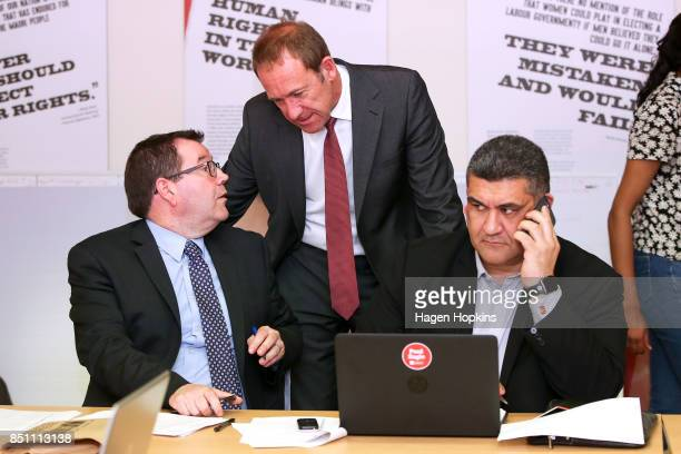 Labour's Rongotai candidate Paul Eagle makes a campaign call while MPs Grant Robertson and Andrew Little talk during a visit to Eagle's phone bank on...