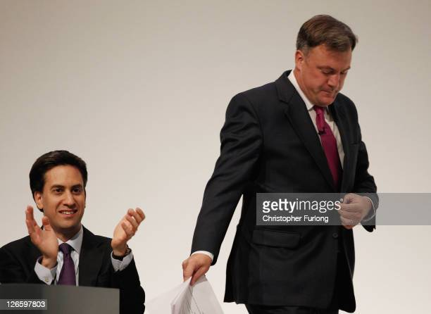 Labour's Shadow Chancellor Ed Balls is applauded by Labour leader Ed Miliband as he prepares to give his keynote speech at the Labour Party...