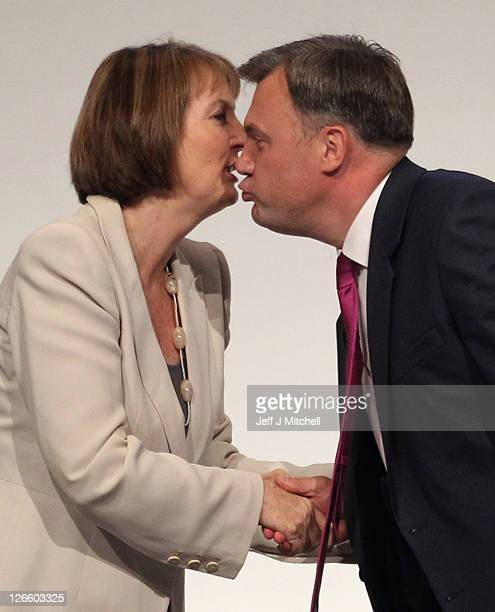 Labour's Shadow Chancellor Ed Balls leans over to kiss deputy party leader Harriet Harman after addressing the Labour Party conference at the Echo...