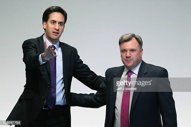 Labour's Shadow Chancellor Ed Balls reacts on stage with Ed Miliband leader of the Labour Party after addressing the Labour party conference at the...