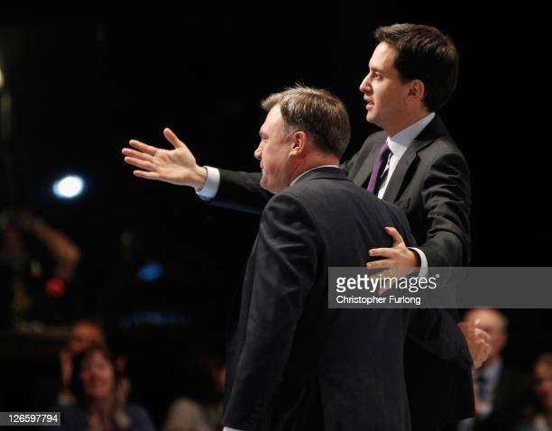 Labour's Shadow Chancellor Ed Balls takes the applause from delgates as he is congratulated by Labour leader Ed Miliband after delivering his keynote...