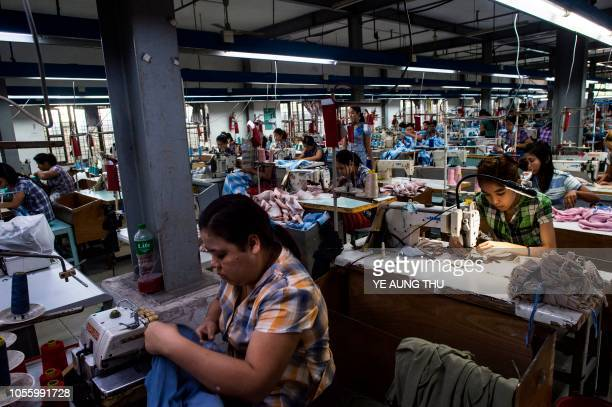 Labours work at a garment factory in Yangon on November 1 2018
