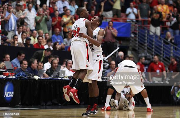 LaBradford Franklin and D.J. Gay of the San Diego State Aztecs celebrate after defeating the Temple Owls 71 to 64 in double overtime during the third...