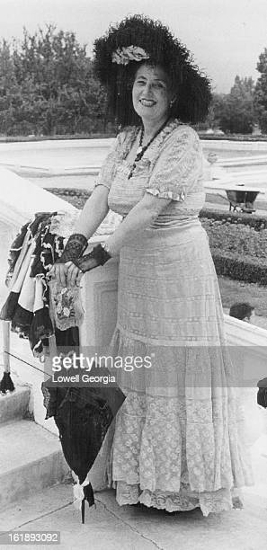 JUN 15 1962 JUN 23 1963 OCT 10 1985 Lace Ball gown modeled by Miss Caroline Bancroft was the style for Central City festivities in '90's Saturday...