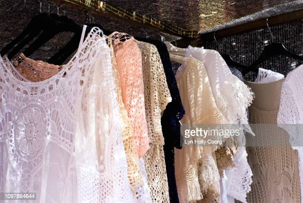 lace beach dresses for sale on market stall in spain - lyn holly coorg stock pictures, royalty-free photos & images