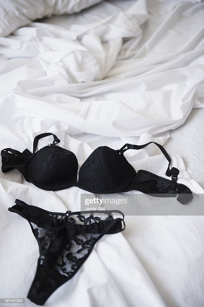 Lace lingerie on bed : Stock Photo