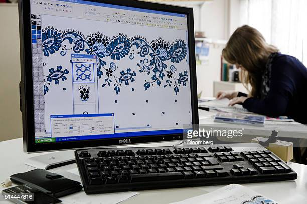 A lace pattern design sits on a desktop computer monitor as an employee works in an office at the Desseilles Laces lace factory in Calais France on...
