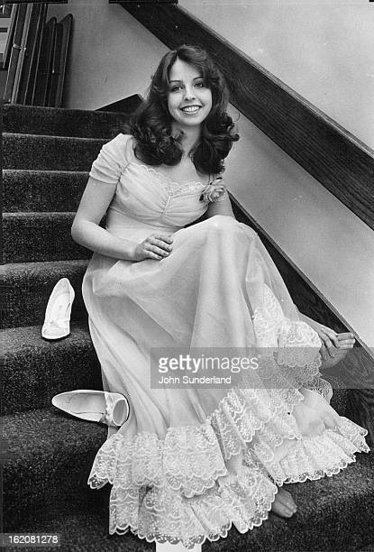 APR 28 1981 MAY 3 1981 Lace ruffles a skirt and the peekaboo gathered bodice of Carol Cornell's blue polyester chiffon gown