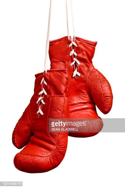 laced red boxing gloves - boxing gloves stock photos and pictures