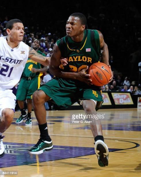LaceDarius Dunn of the Baylor Bears drives against pressure from Denis Clemente of the Kansas State Wildcats on January 21, 2009 at Bramlage Coliseum...