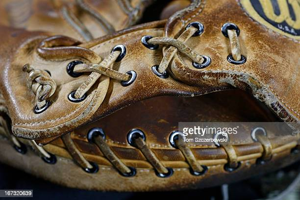 Laces hold together the leather on the catcher's glove belonging to bullpen catcher Mark Salas of the Chicago White Sox who used it in his playing...