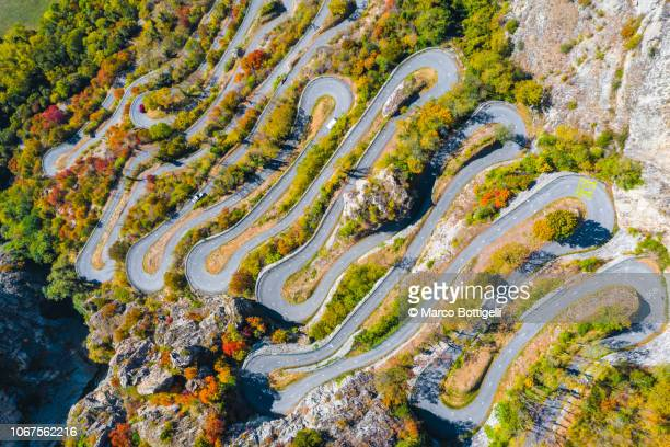 lacets de montvernier winding mountain road - savoie stock pictures, royalty-free photos & images