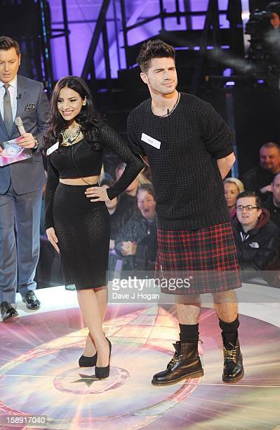 Lacey Banghard and Sam Robertson enter the Celebrity Big Brother House at Elstree Studios on January 3 2013 in Borehamwood England