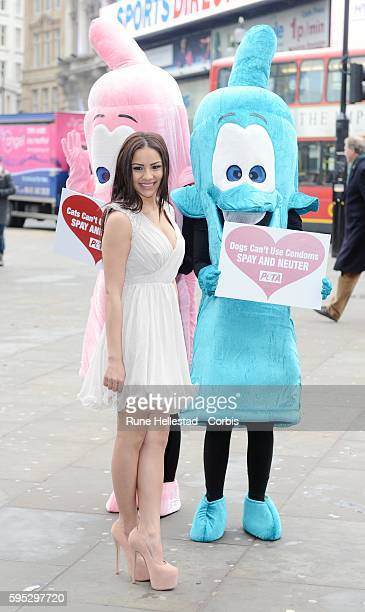 Lacey Banghard attends a photo call for PETA at Piccadilly Circus.