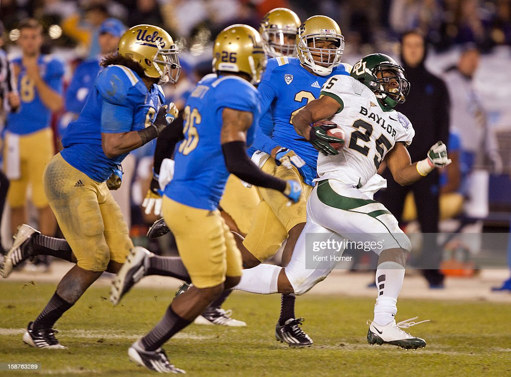 Lache Seastrunk #25 of the Baylor Bears runs with the ball in the second half of the game against the UCLA Bruins in the Bridgepoint Education Holiday Bowl at Qualcomm Stadium on December 27, 2012 in San Diego, California.