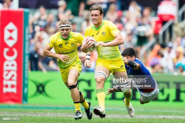 Lachie Aderson of Australia is tackled during the 2017 Hong Kong Sevens match between Australia and South Korea at Hong Kong Stadium on April 8 2017...