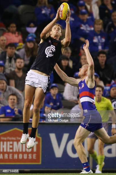 Lachie Henderson of the Blues marks the ball against Tom Young of the Bulldogs during the round five AFL match between the Western Bulldogs and the...