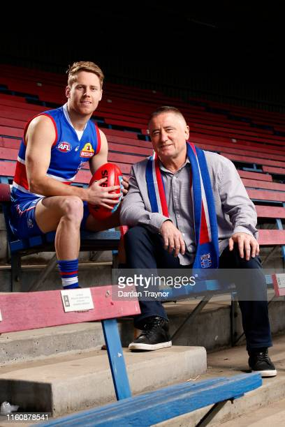 Lachie Hunter and his father Mark Hunter pose for a photo during a Western Bulldogs AFL media opportunity at Whitten Oval on July 09, 2019 in...