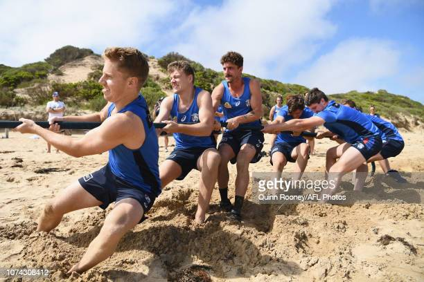 Lachie Hunter , Jackson Macrae and Tom Liberatore of the Bulldogs lead a group in a game of tug of war during a Western Bulldogs AFL pre-season...