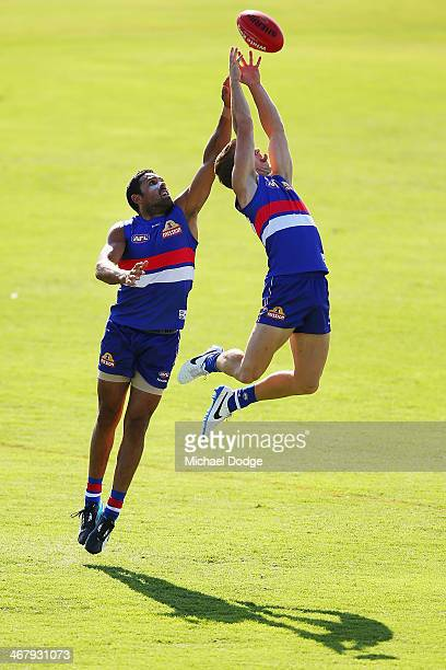 Lachie Hunter marks the ball against Brett Goodes during a Western Bullldogs AFL training session at Victoria University Whitten Oval on February 9...