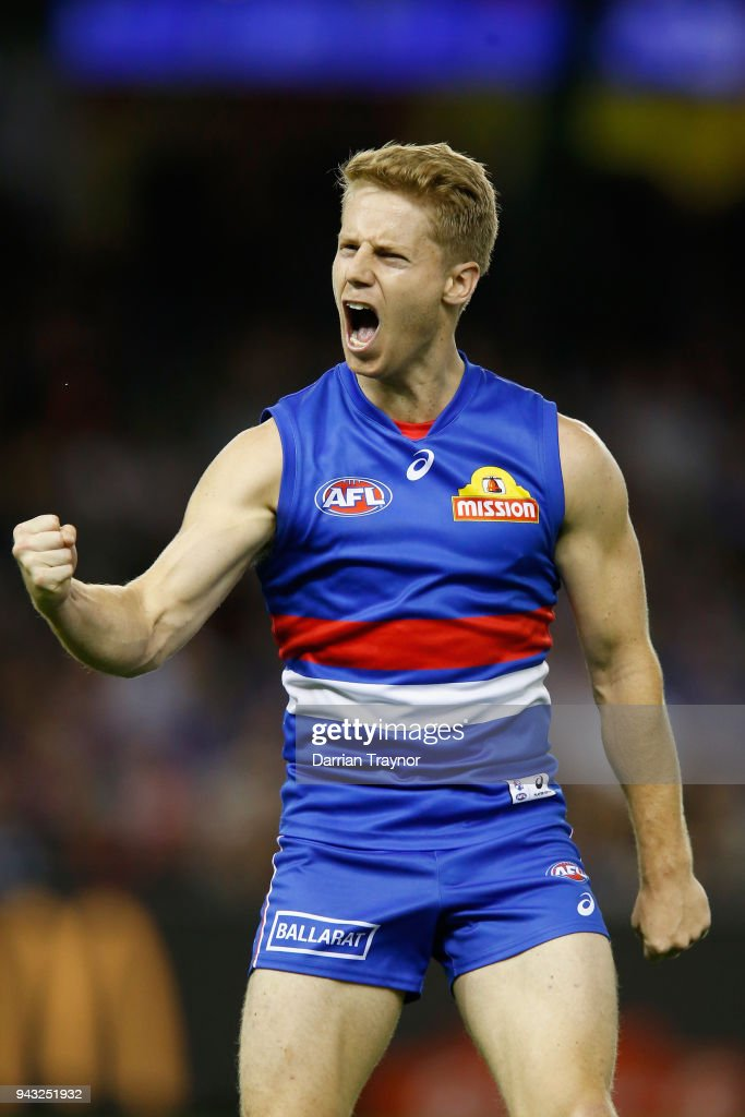 Lachie Hunter of the Bulldogs celebrates a goal during the round three AFL match between the Western Bulldogs and the Essendon Bombers at Etihad Stadium on April 8, 2018 in Melbourne, Australia.