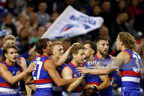 Lachie Hunter of the Bulldogs celebrates a goal during the round five AFL match between the Western Bulldogs and the Gold Coast Suns at Marvel...