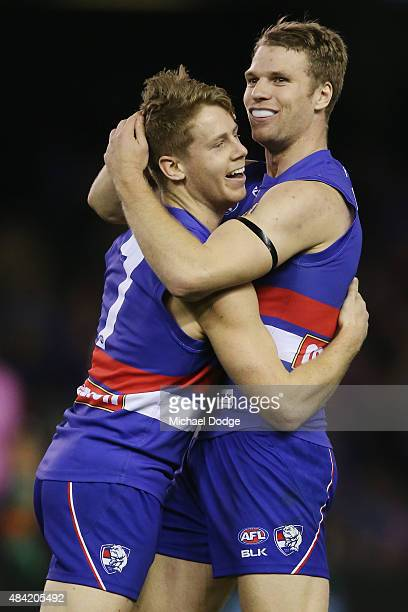 Lachie Hunter of the Bulldogs celebrates a goal with Jake Stringer during the round 20 AFL match between the Western Bulldogs and Melbourne Demons at...