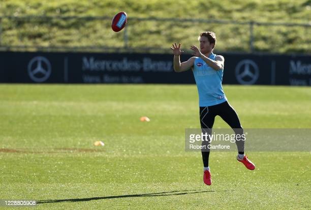 Lachie Hunter of the Bulldogs controls the ball during a Western Bulldogs AFL training session at Whitten Oval on May 29, 2020 in Melbourne,...