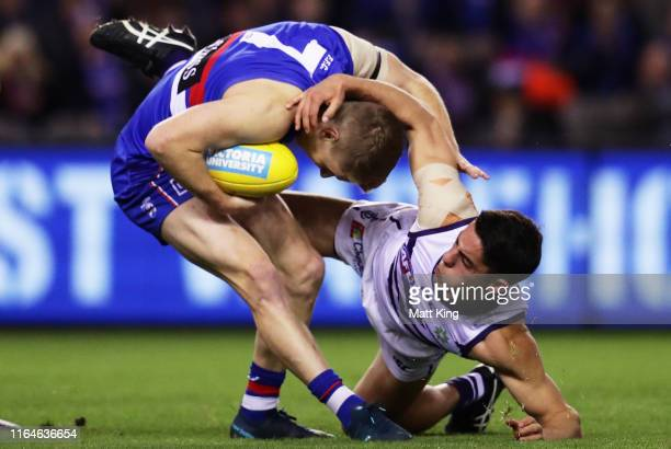 Lachie Hunter of the Bulldogs is challenged by Adam Cerra of the Dockers during the round 19 AFL match between the Western Bulldogs and the Fremantle...