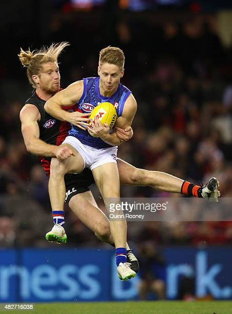 Lachie Hunter of the Bulldogs marks infront of Ariel Steinberg of the Bombers during the round 18 AFL match between the Essendon Bombers and the...