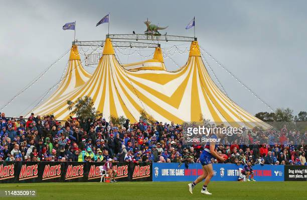 Lachie Hunter of the Bulldogs runs with the ball as the circus takes place next to the ground during the round eight AFL match between the Western...