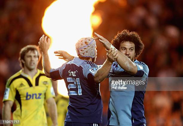Lachie Munro of the Blues celebrates with Rene Ranger after scoring a try as Conrad Smith of the Hurricanes looks on during the round five Super...
