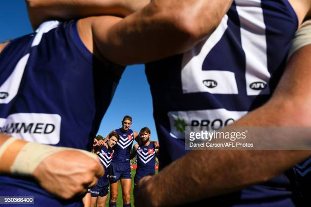 Lachie Neale Aaron Sandilands and Connor Blakely of the Dockers listen at the huddle during the AFL 2018 JLT Community Series match between the...