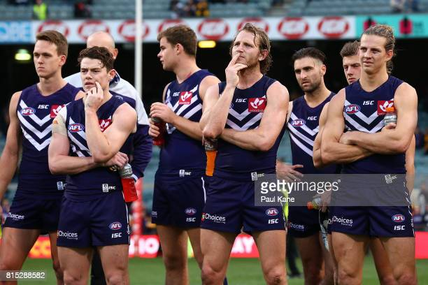 Lachie Neale David Mundy and Nathan Fyfe of the Dockers look on after being defeated during the round 17 AFL match between the Fremantle Dockers and...