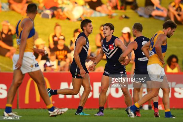 Lachie Neale of the Dockers celebrates a goal during the JLT Community Series AFL match between the Fremantle Dockers and the West Coast Eagles at...