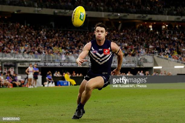 Lachie Neale of the Dockers chases the ball during the round five AFL match between the Fremantle Dockers and the Western Bulldogs at Optus Stadium...