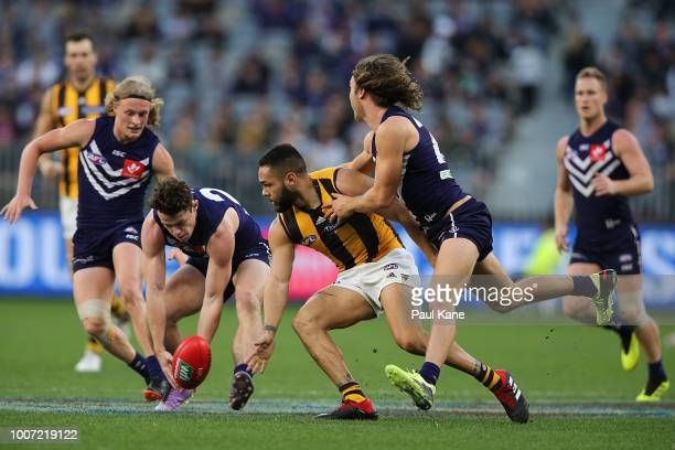 Lachie Neale of the Dockers contests for the ball against Jarman Impey of the Hawks during the round 19 AFL match between the Fremantle Dockers and...