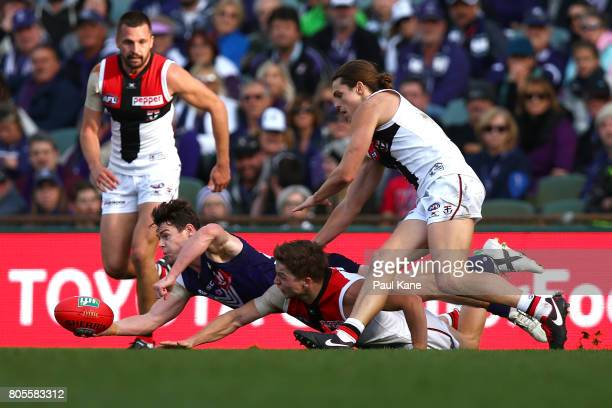 Lachie Neale of the Dockers gets a handball away during the round 15 AFL match between the Fremantle Dockers and the St Kilda Saints at Domain...