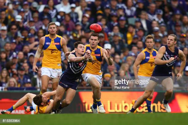 Lachie Neale of the Dockers handballs during the round 17 AFL match between the Fremantle Dockers and the West Coast Eagles at Domain Stadium on July...