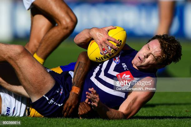 Lachie Neale of the Dockers is tackled to the ground during the AFL 2018 JLT Community Series match between the Fremantle Dockers and the West Coast...