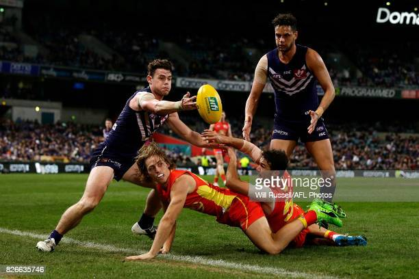 Lachie Neale of the Dockers juggles the ball during the round 20 AFL match between the Fremantle Dockers and the Gold Coast Suns at Domain Stadium on...
