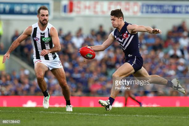 Lachie Neale of the Dockers kicks the ball into the forward line during the round 11 AFL match between the Fremantle Dockers and the Collingwood...