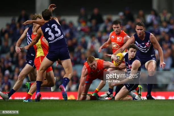 Lachie Neale of the Dockers looks to clear the ball during the round 20 AFL match between the Fremantle Dockers and the Gold Coast Suns at Domain...