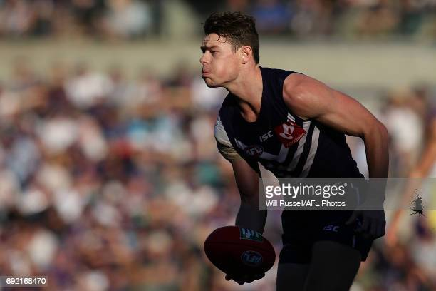 Lachie Neale of the Dockers looks to pass the ball during the round 11 AFL match between the Fremantle Dockers and the Collingwood Magpies at Domain...